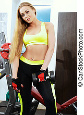 work out - Beautiful athletic young woman working out in a...