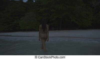 Woman in bikini walking in the see - Asian beautiful sensual...