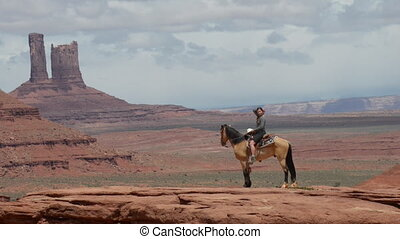 Monument Valley Young Woman Horseback Riding at Johns Ford...