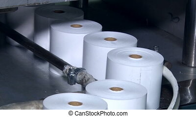 Rolls cut cash tape - Work shop for the production of office...