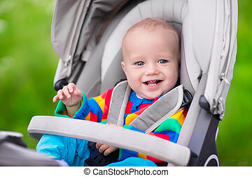 Little baby in stroller - Baby boy in warm colorful knitted...