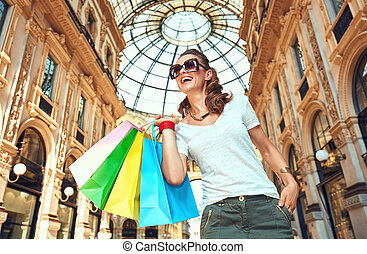 Fashion monger with shopping bags in Galleria Vittorio...