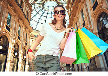 Fashion woman with shopping bags in Galleria Vittorio...