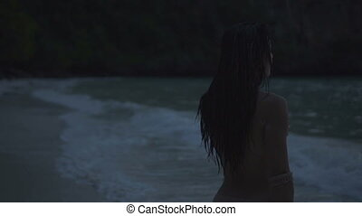 Topless woman walking on the beach - Asian beautiful woman...