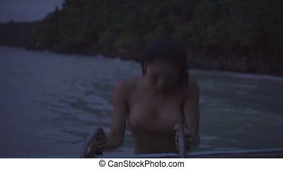 Woman climbing up on boat ladder - Asian beautiful sensual...