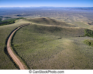 windy back country road aerial view - Independence Mountain...