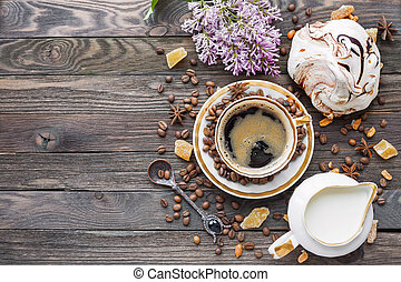 Rustic wooden background with cup of coffee, milk, chocolate...