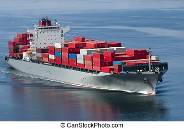 Container Ship - A container ship arriving in port on a very...