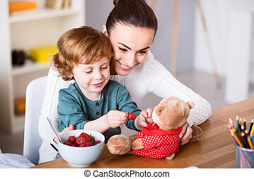 Mother and son feeding teddy bear - I like playing with my...