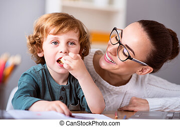 Child eating and mother looking at him - One more piace...