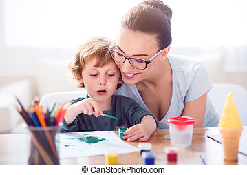 Little boy painting picture for mother - What a wonderful...