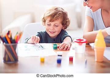 Little boy painting a picture - My favorite color. Relaxed...