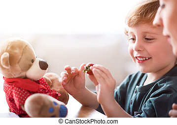 Little boy holding strawberry - It looks so sweet. Smiling...
