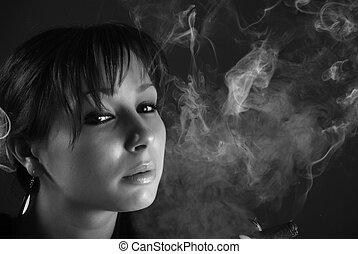Smoking beauty woman - Smoking young woman at black...