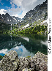 tranquil nature at lake in mountains, water reflection and...