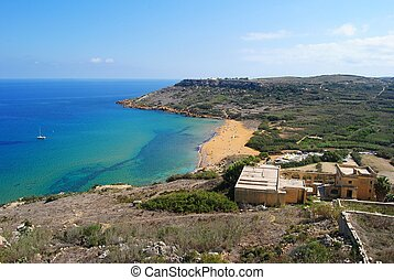 View over Ramla Bay from the Calypso's Cave. The dark blue...