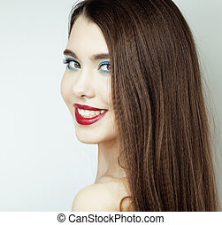 Sexy Beauty Girl with Red Lips and Nails. Provocative Make up. Luxury Woman with Blue Eyes. Fashion Brunette Portrait isolated on a white background. Gorgeous Woman Face. Long Hair closeup