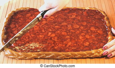 Cutting of a strawberry pie using a steel knife - The...