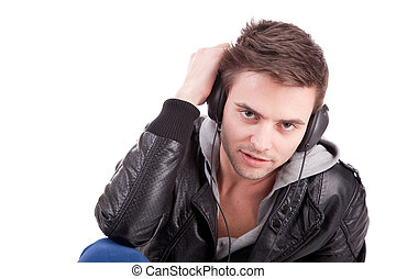 Young man listening to music - isolated