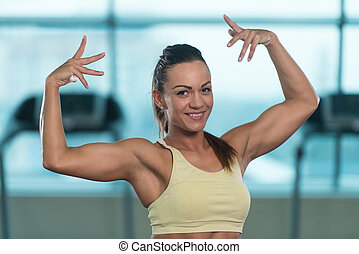 Young Sexy Fitness Woman Posing In Gym