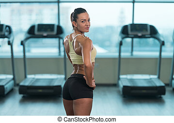 Young Sexy Fitness Woman Posing In Gym - Portrait Of A Young...