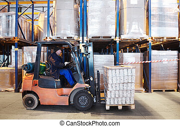 warehouse work with forklift loader