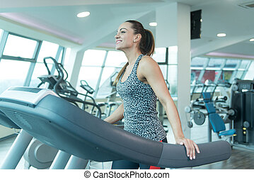 Fitness Woman Exercising On A Treadmill