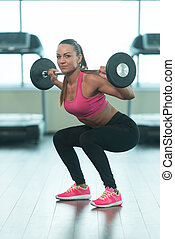 Healthy Young Woman Doing Exercise For Legs