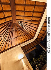Traditional Roof design decoration in modern hotel at night