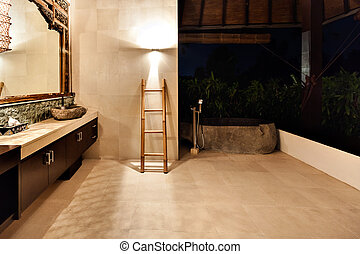 Outside washroom and bathing tub covered with trees