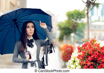 Girl Calls for a Taxi in the Rain - Urban girl looking for a...