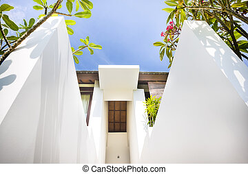 Low angle view of modern mansion entrance with hugh and tall...