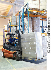 Forklift loader at a warehouse