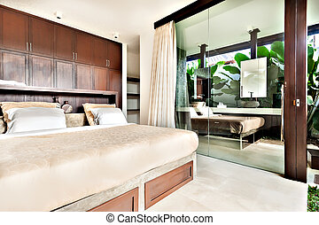 Modern bedroom with glass doors and windows - inside of a...