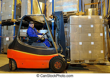 forklift loader worker at warehouse - Worker driver of a...