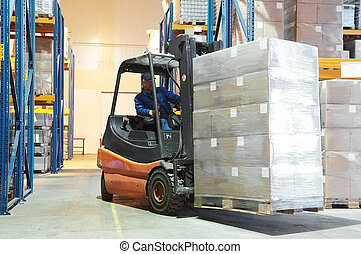 warehouse forklift loader - Forklift loader moving at...