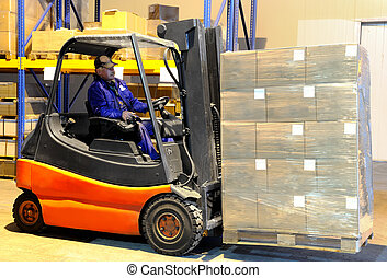 worker and forklift loader at warehouse - Worker driver of a...