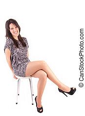 Beautiful brunette sitting on a chair