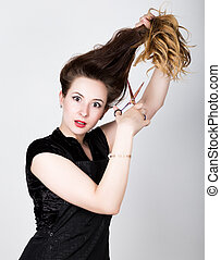 female Hairdresser trying to cut your own hair with scissors
