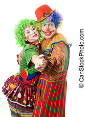 A couple of happy clowns dancing