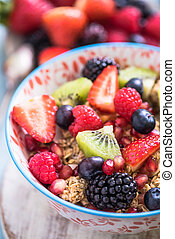 sumer breakfast, berries and cereal in bowl