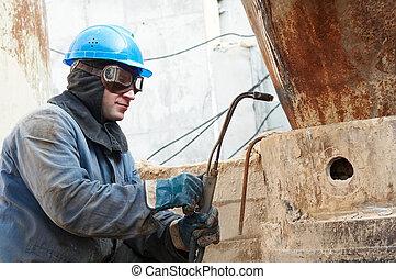 welder working with gas torch