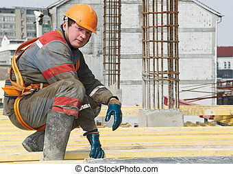 builder worker at construction site - Young builder worker...