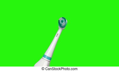 electric toothbrush on isolated green screen