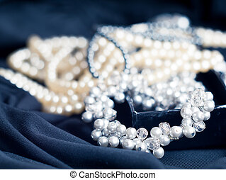 Pearl necklace with blurred background on black