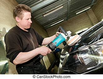 car polishing worker - car care work with machine polisher...