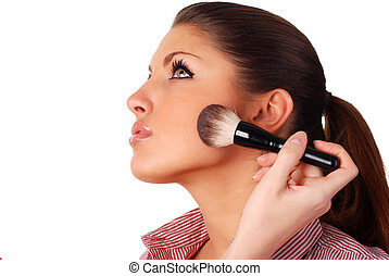 face of a woman - face of a beautiful woman and brush for...