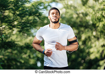 Attractive african sportsman running in park - Attractive...