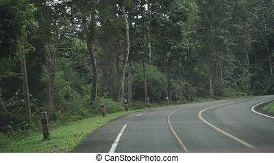 Thai rural jungle road. First person view clip