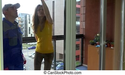 finicky young client woman give instructions for windows...